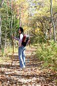 Teen With Hiking Stick Pauses On The Trail poster