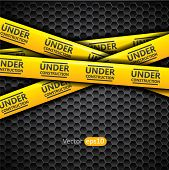 Under construction caution tape on metallic background, vector