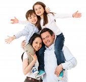 foto of family bonding  - Happy family celebrating with arms up  - JPG