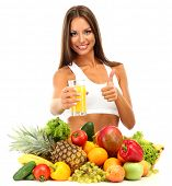 beautiful young woman with fruits and vegetables and glass of juice, isolated on white