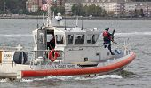 NEW YORK-OCT 6: Armed Coast Guard patrols the Hudson River near the USS Michael Murphy (DDG 112) doc