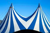Circus tent stripped blue and white over clear sky