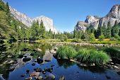 The magnificent Yosemite Valley. The huge granite monolith El Capitan and the blue sky reflected in