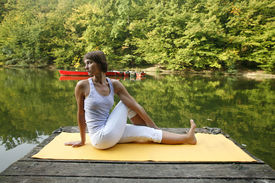 pic of yoga mat  - Woman doing yoga on lake in park in autumn - JPG