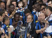 MADRID, SPAIN. 22/05/2010. UEFA President Michel Platini presents the trophy to Milan after they won the  Champions League final. played in The Santiago Bernabeu Stadium, Madrid.