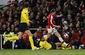 LONDON, ENGLAND. 31/03/2010. Barcelona's Dani Alves and Arsenal player Nicklas Bendtner in action du