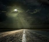 image of headlight  - Dramatic sky over an asphalt road - JPG