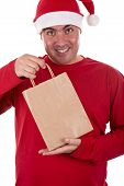 Man In Santa Hat Holding A Paper Bag - Focus On The Bag