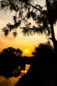 Silhouette Sunset Over Canal, Chiang Mai, Thailand.