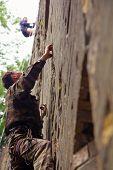 Rock Climber Climbing Up