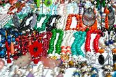 Necklaces, bracelets, earrings and brightly colored