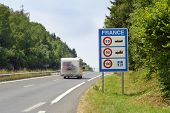 picture of camper-van  - Camper passing the Sign of Speed limits at the French border - JPG