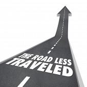 stock photo of divergent  - The Road Less Traveled words on a street or freeway with arrow leading up to illustrate that the different - JPG