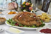 Roasted turkey on table set for Thanksgiving