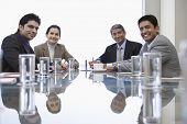 Portrait of Indian business people sitting at conference table