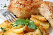 picture of roast chicken  - grilled chicken leg with potato and parsley - JPG