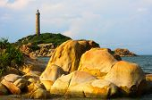 Lighthouse In Early Morning Sunshine, Sun Shines On The Rocks, Binh Thuan Province, Vietnam