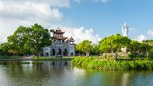 Phat Diem Cathedral, Church And God Statues Reflected In The Lake, Blue Sky With Clouds, Ninh Binh P