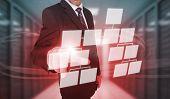 Businessman touching futuristic flowchart interface in data center
