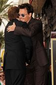 Jerry Bruckheimer and Johnny Depp at the Jerry Bruckheimer Star on the Hollywood Walk of Fame ceremo
