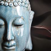 stock photo of stone sculpture  - Buddha close up portrait over dark background - JPG
