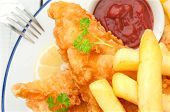stock photo of hake  - Close up of fried and battered fish on a plate - JPG