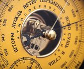 picture of barometer  - Closeup fragment of vintage yellow Russian barometer - JPG