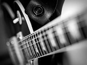 stock photo of fret  - Macro abstract black and white photo of the neck and frets of an electric guitar.