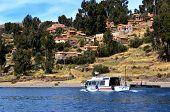 Tourist Boat In Amantani On Lake Titicaca