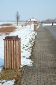 foto of dust-bin  - Brown wooden dust bins on parking nearby motorway - JPG