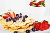 Crisp Golden Fresh Baked Waffle Topped With Strawberries And Blueberry