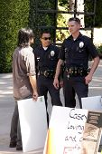 Police officers and protester at a protest involving Casey Kasem's children, brother and friends who