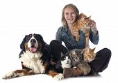 stock photo of coon dog  - woman and pet in front of white background - JPG