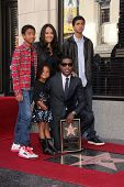 Kenny 'Babyface' Edmonds and family at the Kenny