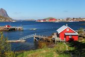 pic of lofoten  - Picturesque fishing town of Reine by the fjord on Lofoten islands in Norway - JPG