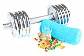 Dumbbell and colorful pills, tablets, isolated on white