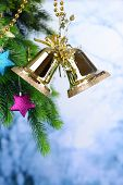 Bells with Christmas decoration on light background