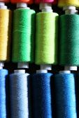 Multicolor sewing threads background