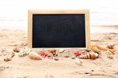 Blank chalkboard on beach background