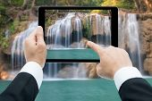 Businessman Hands Tablet Taking Pictures Waterfall Deep Forest  At Erawan Waterfall National Park