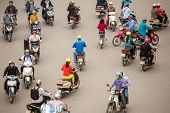 HANOI - 8 APRIL: Top view of people and traffic in Hoan Kiem district (old quarter) in Hanoi, Vietna