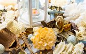 Dried flowers with lamp and candle
