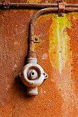 Old Switch On A Rusty Iron Wall