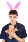 stock photo of retarded  - Infantile Teenager with Bunny Ears and Teddy Bear Isolated on the White Background - JPG