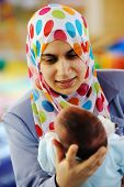 Muslim mom with newborn baby several days old enjoying new life