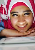Portrait of beautiful Arabic Muslim girl using tablet