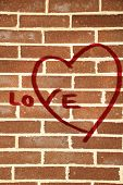 Graffiti heart on brick wall
