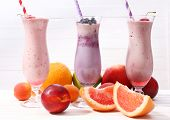 Delicious milkshakes on table, close-up