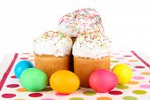 Sweet Easter cakes with colorful eggs isolated on white
