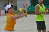 MOSCOW, RUSSIA - JULY 17, 2014: Mixed team Bulgaria in the match with San Marino during ITF Beach Tennis World Team Championship. San Marino won the round 3-0